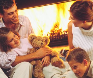 family around fireplace