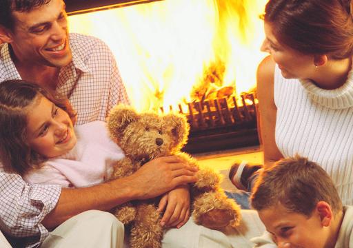 family around fireplace